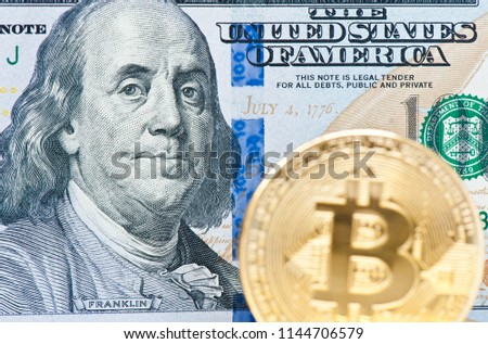 Bitcoins. Cryptocurrency. 100 Dollars banknote background #1144706579
