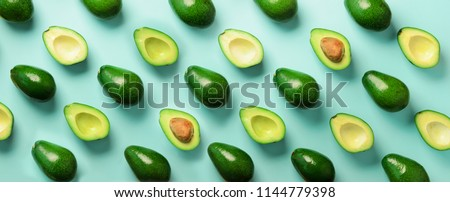 Avocado pattern on blue background. Top view. Banner. Pop art design, creative summer food concept. Green avocadoes, minimal flat lay style. Banner. #1144779398