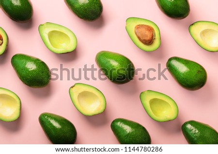 Avocado pattern on pink background. Top view. Banner. Pop art design, creative summer food concept. Green avocadoes, minimal flat lay style #1144780286