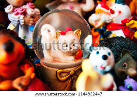 figurine of a cat in a glass souvenir bowl Royalty-Free Stock Photo #1144832447
