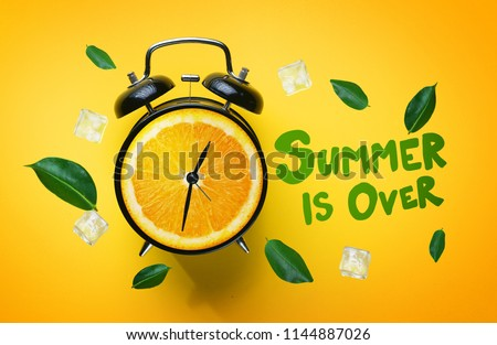 Summer is Over Typography. Alarm Clock of Orange Fruit Green Leaves and Ice Cube Flying Around on Yellow Background