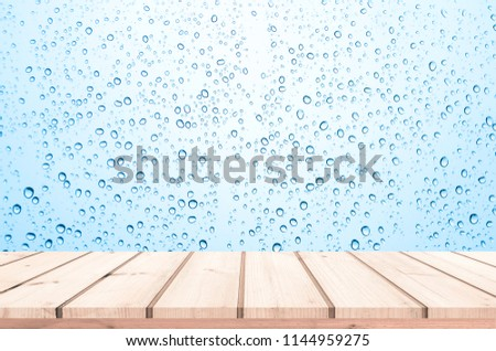 Wood plank with abstract water drop on glass background for product display  #1144959275