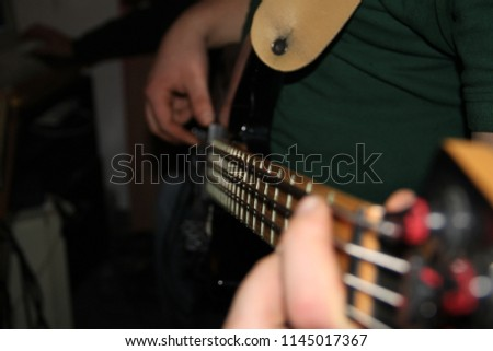 Playing the bass guitar #1145017367