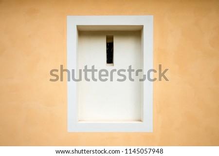 White framed window recession in peach orange wall #1145057948