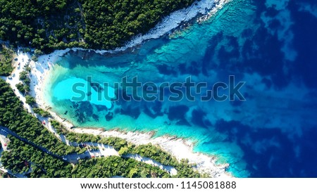 Aerial drone photo of tropical Caribbean bay with white sand beach and beautiful turquoise and sapphire clear sea
