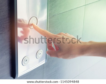 finger presses the elevator button,up and down button.woman pressing elevator button. finger presses the elevator button. #1145094848