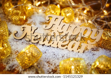 Happy New Year text of the wooden words. Winter holidays New years text. cute colorful decoration. Winter holidays for children. #1145121329