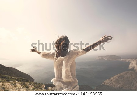 woman taking a breath in front of a spectacular view Royalty-Free Stock Photo #1145153555