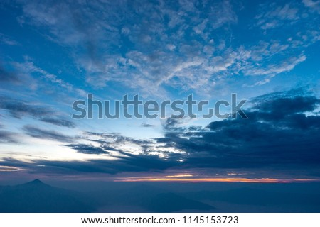 Morning dark sky with the blue cloud and rim light of the sunrise on the top of mountaing view of north side of Chaing-rai provice,Thailand. #1145153723