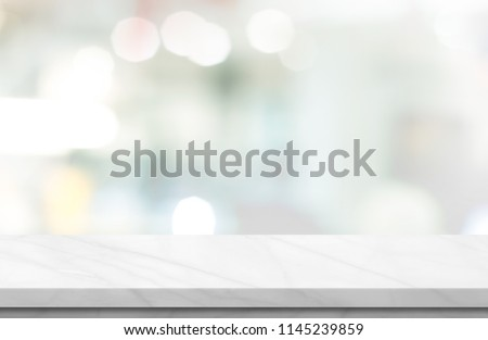 Empty white marble over blur background, for your photo montage or product display, Space for placing items on the table, product and food display. #1145239859