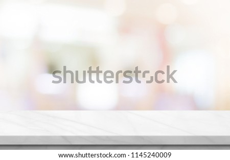 Empty white marble over blur background, for your photo montage or product display, Space for placing items on the table, product and food display. #1145240009