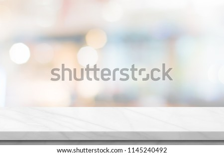 Empty white marble over blur background, for your photo montage or product display, Space for placing items on the table, product and food display. #1145240492