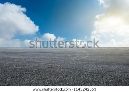 Car drift asphalt square under the blue sky #1145242553