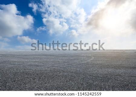 Car drift asphalt square under the blue sky #1145242559