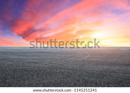 Empty asphalt square landscape at sunrise
