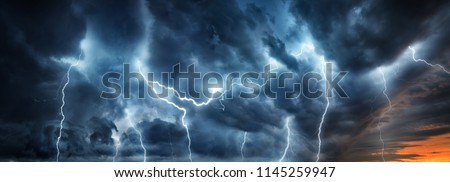 Lightning thunderstorm flash over the night sky. Concept on topic weather, cataclysms (hurricane, Typhoon, tornado, storm)  Royalty-Free Stock Photo #1145259947