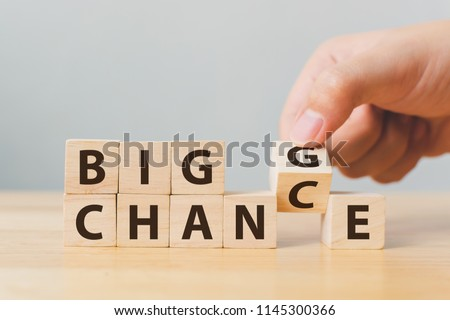 Hand flip wooden cube with word change to chance, Personal development and career growth or change yourself concept #1145300366