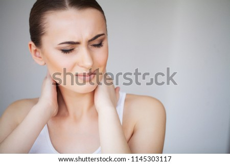 Pain. Beautiful Young Woman Feeling Sick and Has a Pain in the Neck. #1145303117