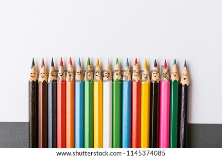Color pencils with faces painted on them. the concept of a multinational family and equality in the world. #1145374085