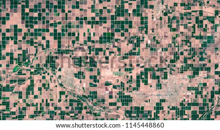 High resolution satellite image of irrigated agricultural rectangle fields from above, El Centro, US, aerial view, background texture, contains modified Copernicus Sentinel data [2018]