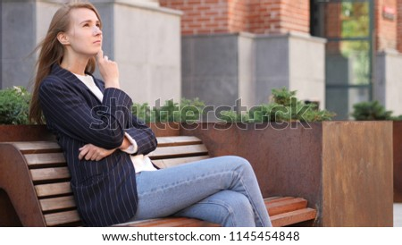 Pensive Business Woman Thinking while Sitting Outside Office on Bench #1145454848