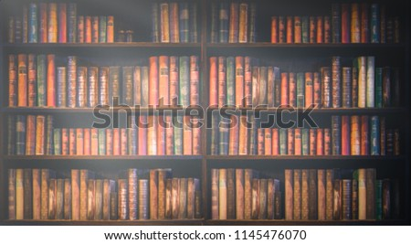 blurred bookshelf Many old books in a book shop or library. #1145476070