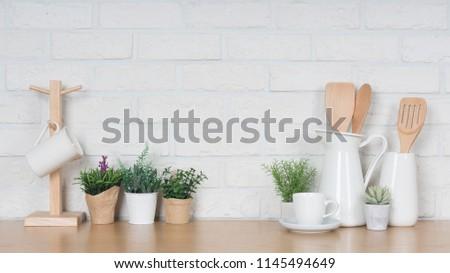 Kitchen utensils and dishware on wooden shelf. Kitchen interior background.Text space. #1145494649
