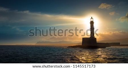 A beautiful night sky behind a shining lighthouse. Chania, Crete, Greece Royalty-Free Stock Photo #1145517173