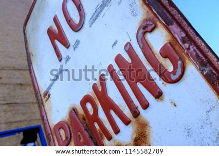 No Parking Sign With Red And White