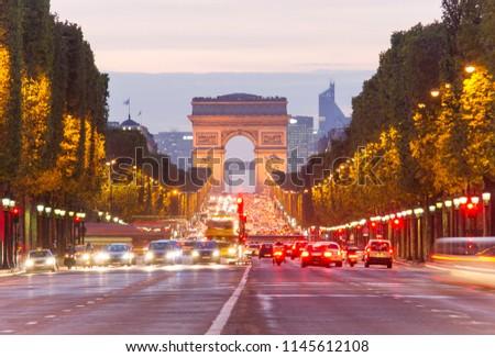 PARIS, FRANCE - SEPTEMBER 22 2011: car traffic at Champ D'Elysees boulevard in Paris city, France. night scene #1145612108