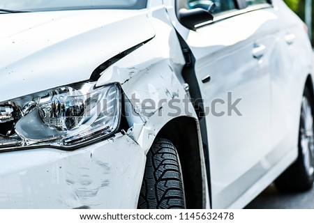 Car crash or accident. Front fender and light damage and scratchs on bumper. Broken vehicle detail or close up.  #1145632478