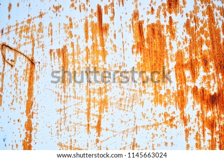 Rusted white painted metal wall. Rusted metal background with streaks of rust. Rust stains. Rust texture. #1145663024