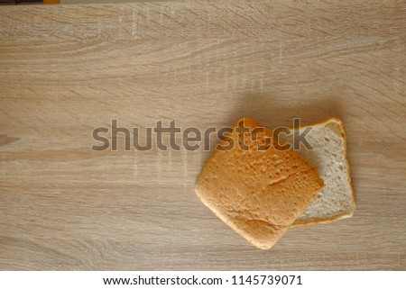 Whole wheat bread on wood table #1145739071