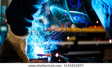 Welding working process. Engineer welder, connects the parts with a welding arc #1145822897