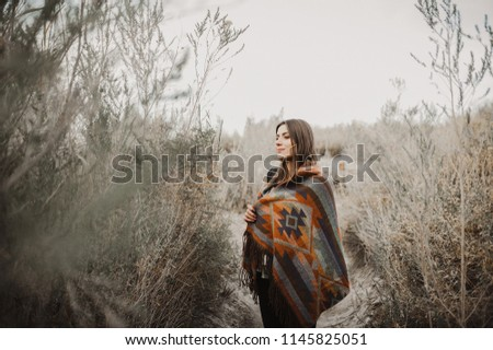 Boho woman with windy hair. Hipster girl in gypsy look, young traveler in the desert nature. #1145825051