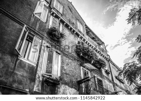 MURANO, ITALY - AUGUST 19, 2016: Famous architectural monuments and facades of old medieval buildings. Black-white photo on August 19, 2016 in Murano, Italy. #1145842922