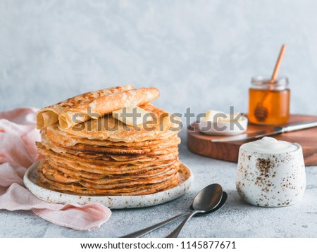 Stack of traditional russian pancakes blini on gray background with copy space. Homemade russian thin pancakes blini. Russian food, russian kitchen #1145877671