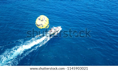 Aerial drone photo of speed boat with Parasail baloon in tropical turquoise clear sea #1145903021