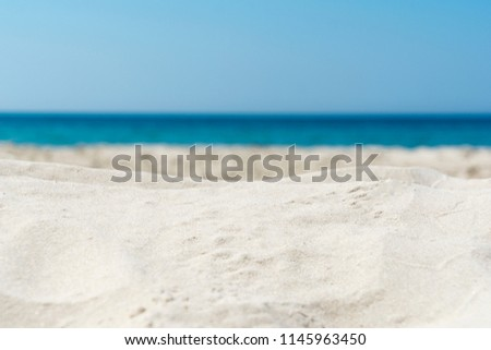 Background of blurred sand beach and sea waves with bokeh lights #1145963450
