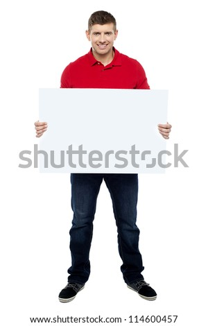 Handsome guy presenting blank billboard to camera isolated against white background #114600457