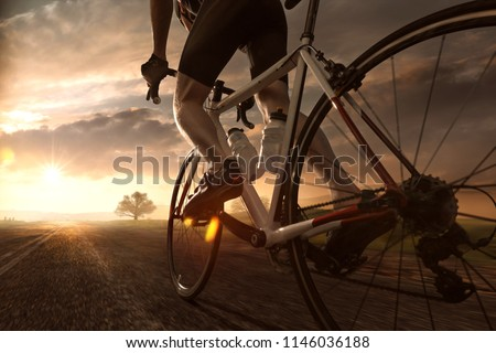 Biker rides into sunset #1146036188