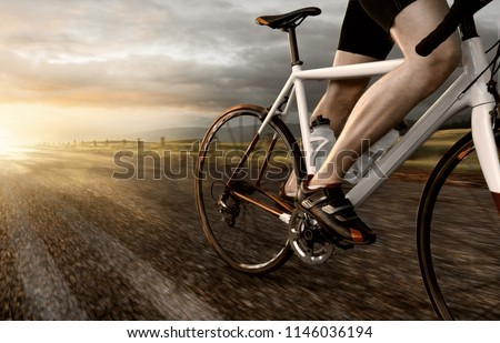 Racing bike on country road #1146036194