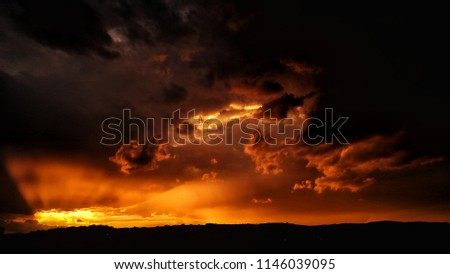 Apocalyptic sunset with fire clouds Royalty-Free Stock Photo #1146039095
