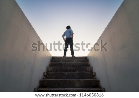 Businessman climbed on top of the stairs going to the city,  Ambitions concept 