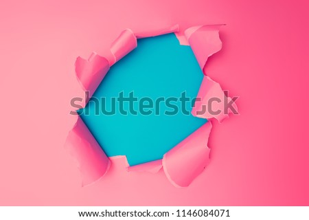 Vivid pink torn paper. Burst hole background. Minimal abstract colorful wallpaper concept.