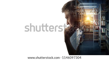 Silhouette of a thinking man on the library hall background with books in bookshelf. Concept on education, science, literature, psychology, philosophy and history topics. #1146097304