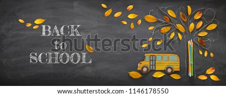 Back to school concept. Top view banner school bus and pencils next to tree sketch with autumn dry leaves over classroom blackboard background