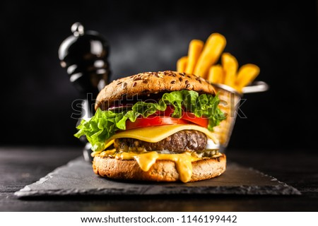 Delicious grilled burgers #1146199442