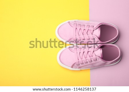 Stylish new shoes on color background, top view Royalty-Free Stock Photo #1146258137