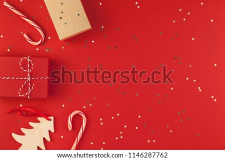 New Year Christmas presents wrapped ribbon flat lay top view Xmas holiday 2019 celebration handmade gift boxes red paper golden sparkles background copyspace. Template mockup greeting card text design #1146287762